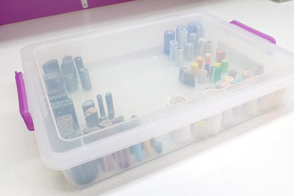 I like using low, flat plastic boxes to store polymer clay canes.