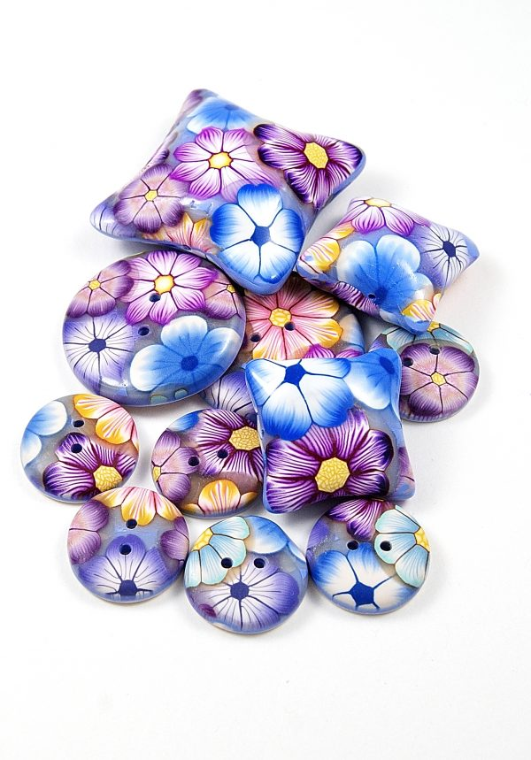 These millefiori beads are made with slices cut from polymer clay flower canes.