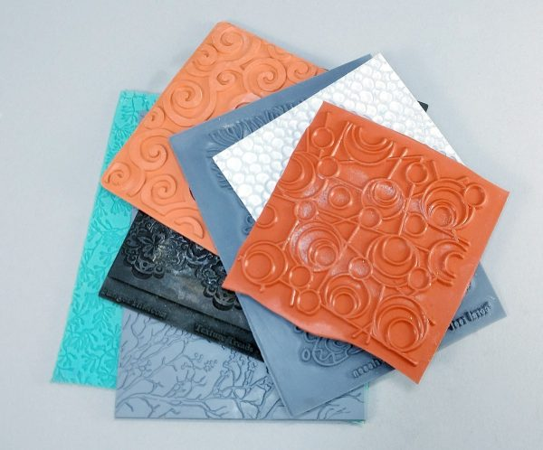 Texture sheets are unmounted stamps used to give polymer clay texture or surface designs.