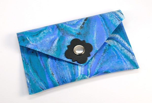 Sheets of marbled Fimo Leather can be baked and then sewn together to make vegan faux leather crafts.