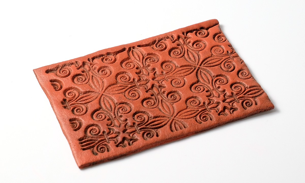 Textured Fimo Leather can look very much like tooled leather.