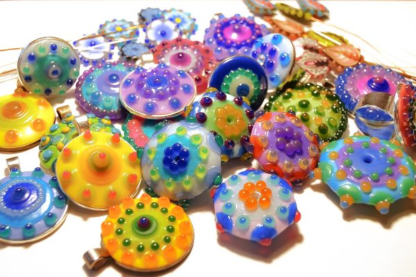 pile of faux lampwork beads made with polymer clay