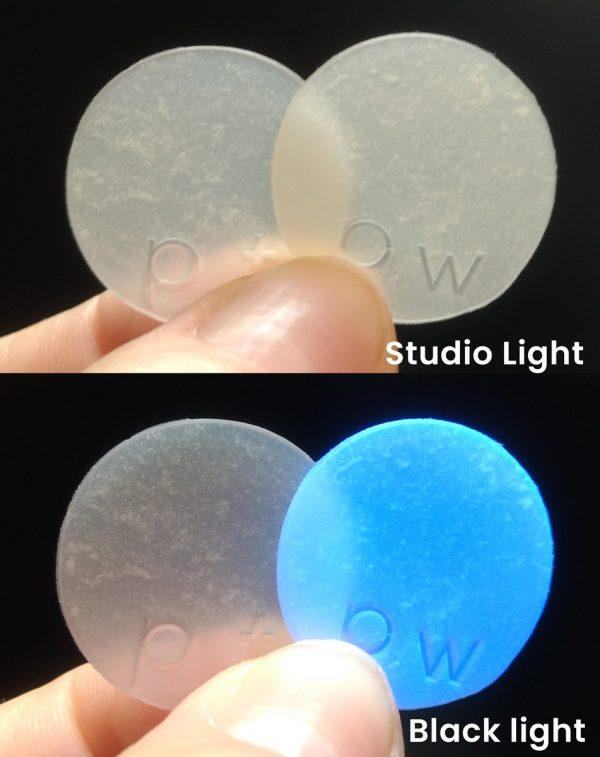 photo comparing Premo Translucent with Premo White Translucent under black light.