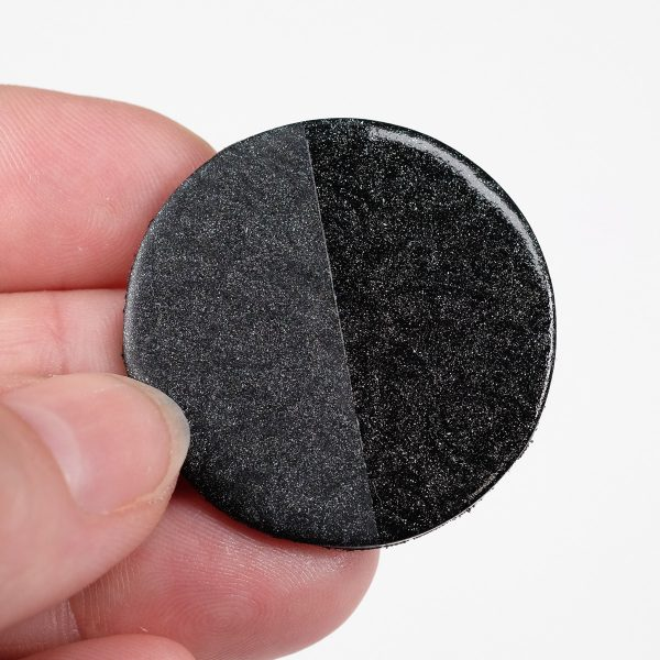Cernit pearl black, baked, with varnish on half.