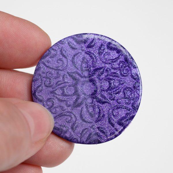 Cernit pearl violet, baked, with varnish on half.